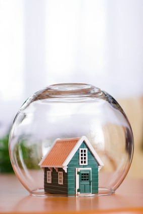 Conceptual view of protecting a house - real estate insurance